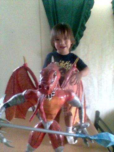 carlos paper mache dragon withchild