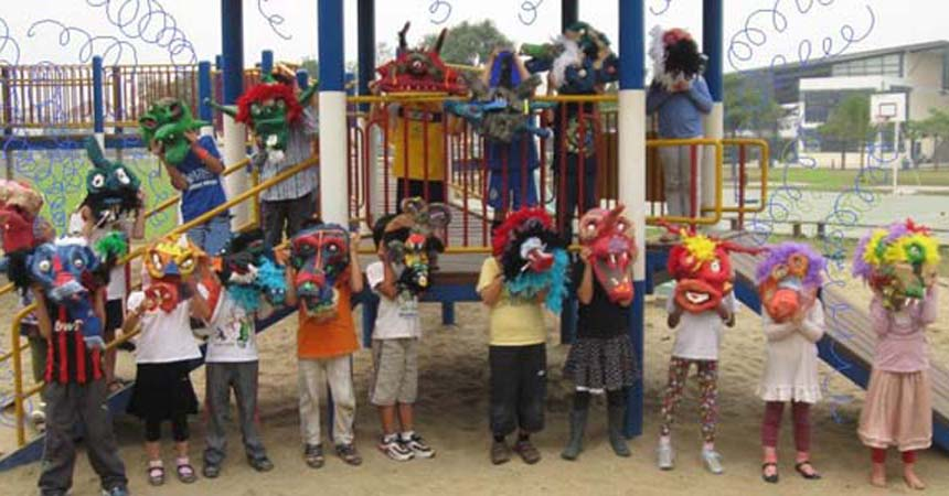 1st grade and paper mache masks-featured