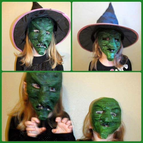 Arial and Leah with their paper mache witch masks