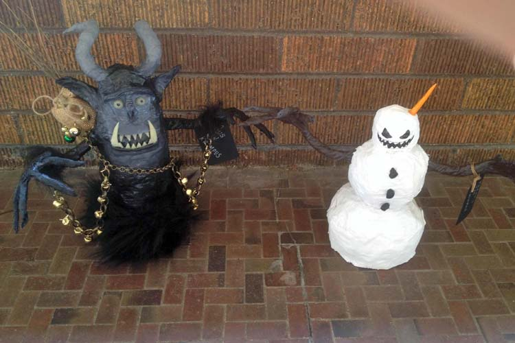 Jeff Sherer's paper mache Freaky the snowman and Krampus