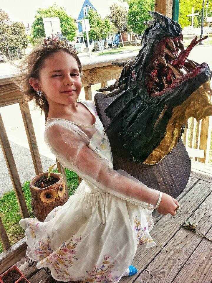 Michael Mccaffrey's paper mache dragon trophy with daughter Raven