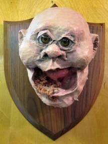 paper mache baby on a plaque