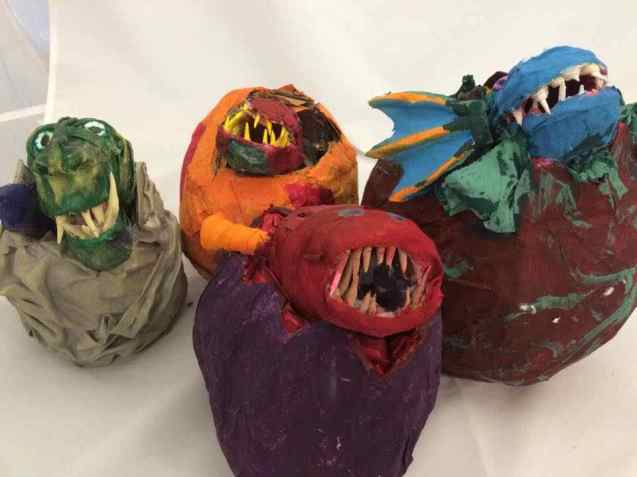 Student's paper mache baby dragons from Kathy Nelson's art class