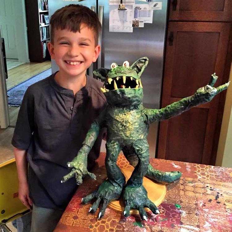 Leslie's grandson, Kiran, and their paper mache monster