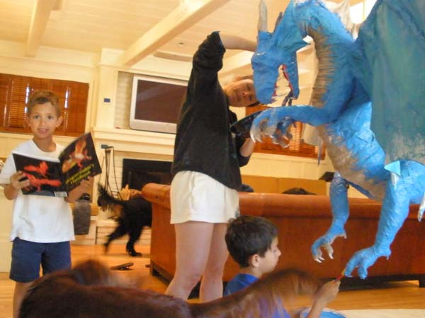 dulcie and kids making their paper mache dragon