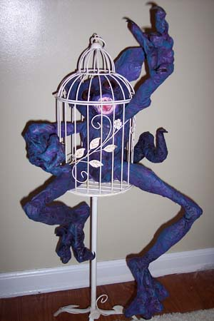 tracys paper mache monster in cage
