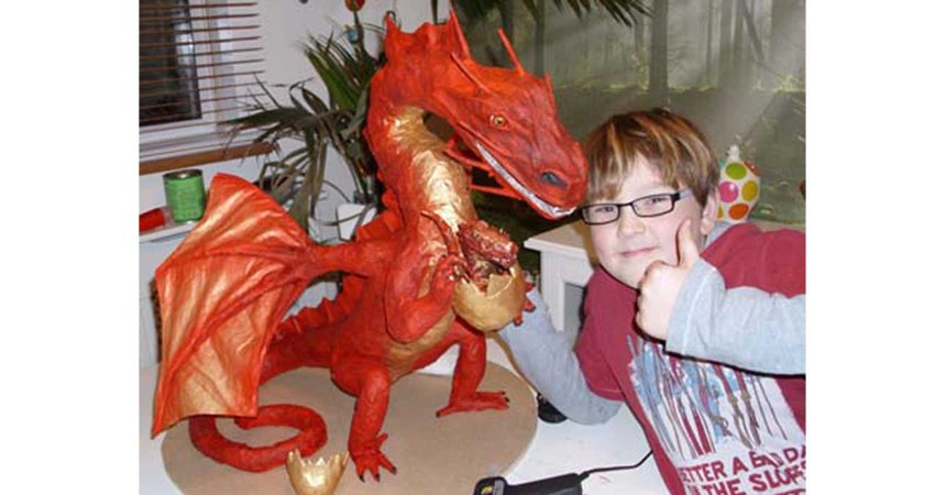 Jack with his paper mache dragon (and baby)