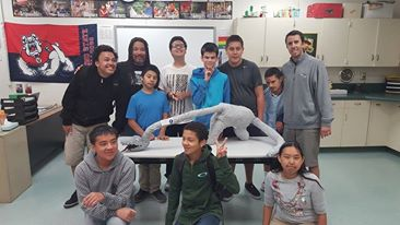 Bryan Medina and Mr Hill's class with their paper mache award winning dinosaur