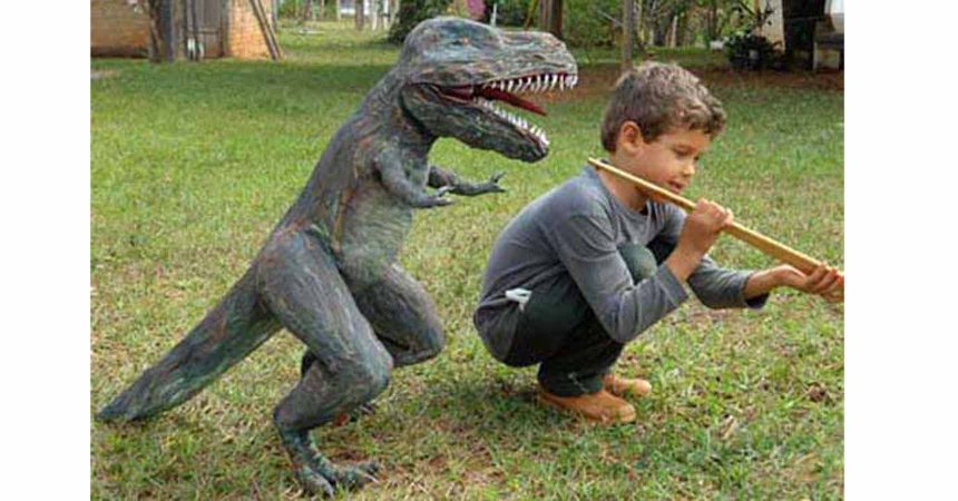 Alex's T-rex along with his son, Girassol.