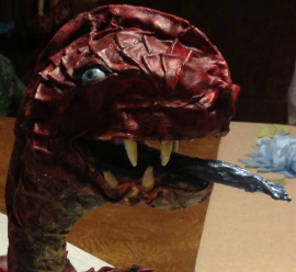 The dennis family paper mache monster close up