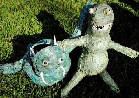 Pru and Luke and Gus paper mache monsters