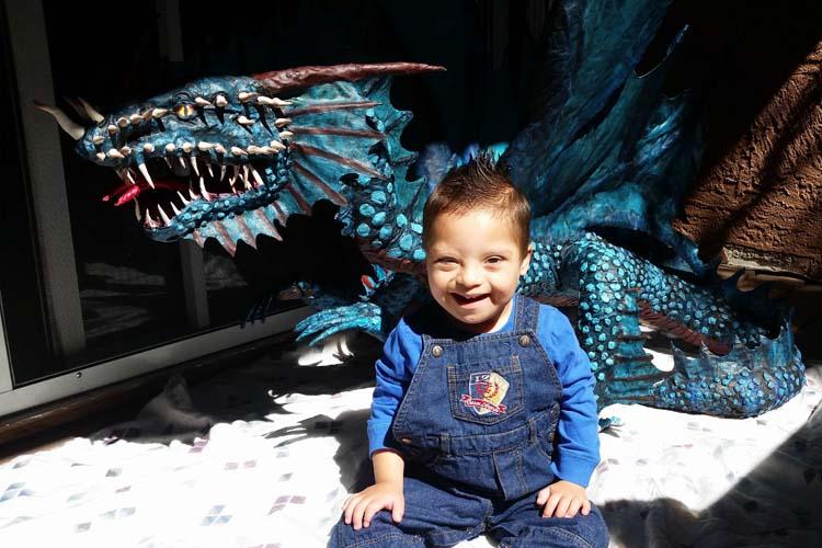 Frank Carrillo's paper mache dragon with Kobe