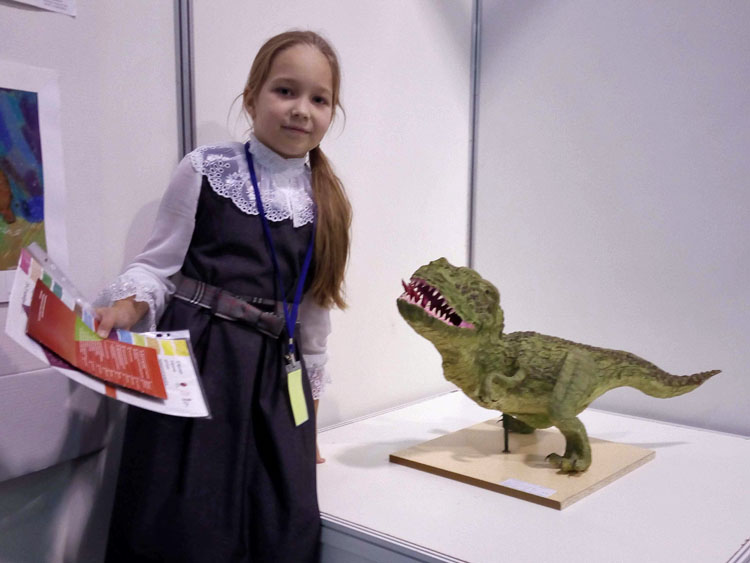 Julia with her paper mache dinosaur