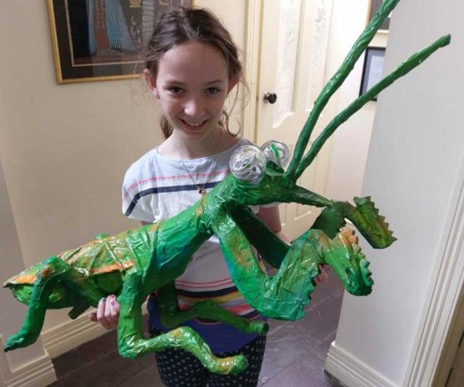 Isabel and her paper mache praying mantis made with Grandpa Richard