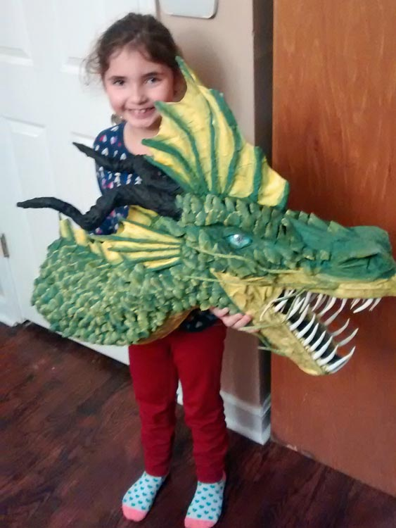 Alex holding our first paper mache dragon sculpture.